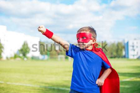 Superhero looking from under his hand Stock photo © Agatalina