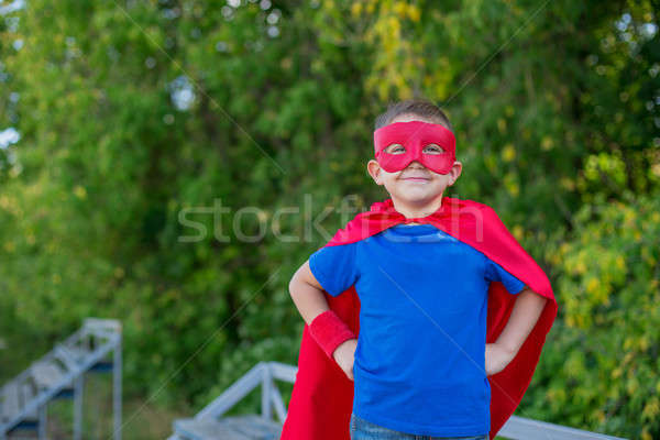 Superhero standing with hands on hips and smiling Stock photo © Agatalina