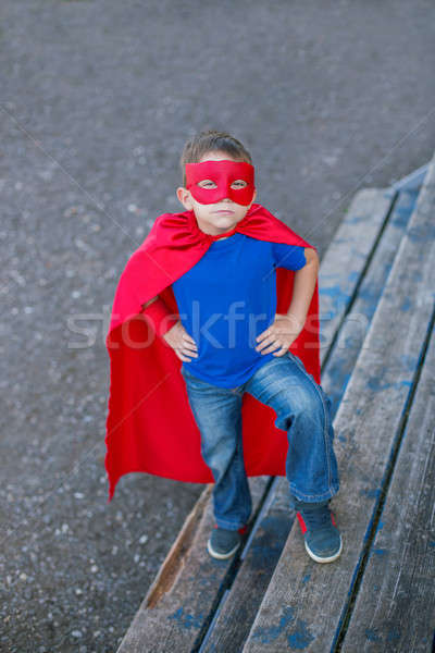 Superhero standing with hands on hips and looking up Stock photo © Agatalina