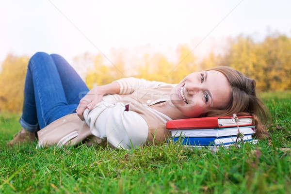 студент зеленая трава книгах закат солнце Сток-фото © Agatalina