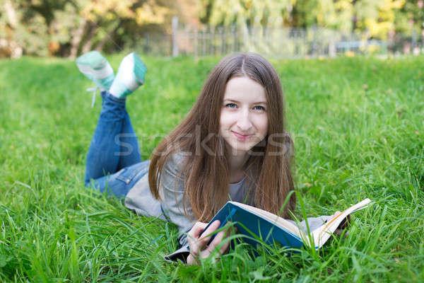Stock photo: Student lying on grass