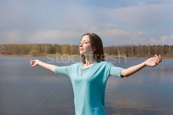 Girl with closed eyes smiling to sun Stock photo © Agatalina