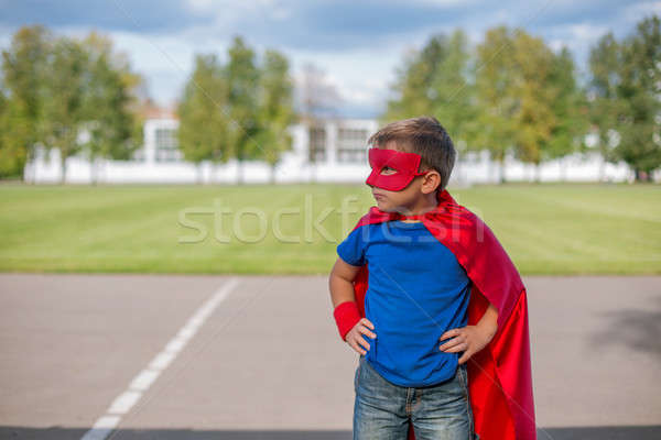 Superhero standing with hands on hips and looking sideways Stock photo © Agatalina