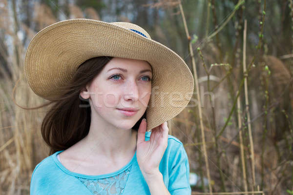 Girl in hat dreaming Stock photo © Agatalina