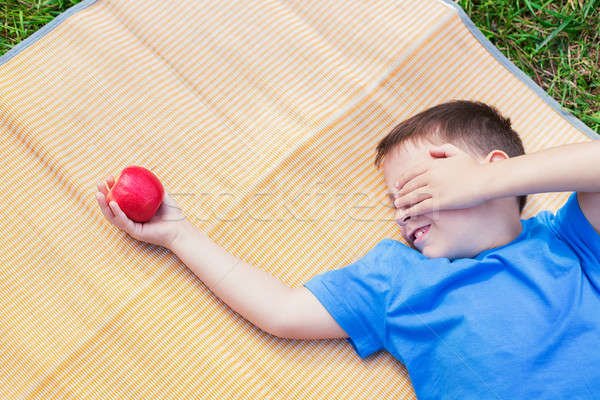 Boy looking at apple and covering eye by hand Stock photo © Agatalina