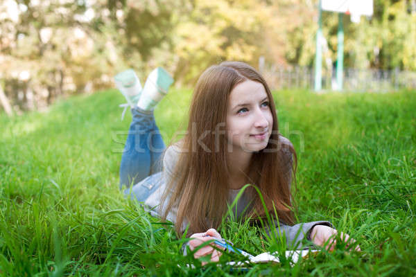 Student lying on grass and thinking Stock photo © Agatalina
