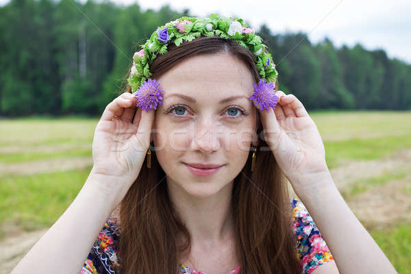 Girl holding two field flowers Stock photo © Agatalina