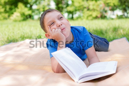 Boy dreaming on the book Stock photo © Agatalina
