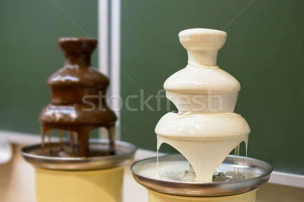 Two chocolate fountains Stock photo © Agatalina