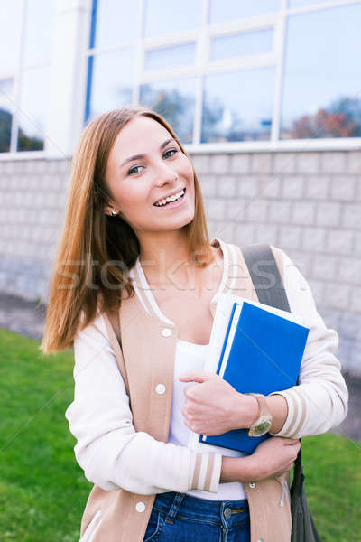 Student tilting her head to the side and smiling Stock photo © Agatalina