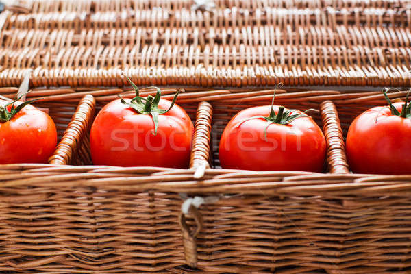 Tomatoes with dew lying in wicker box Stock photo © Agatalina