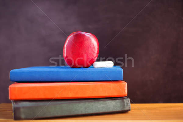 Red apple and chalk on books  Stock photo © Agatalina