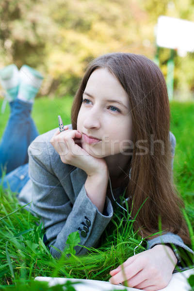 Student with pen thinking on grass Stock photo © Agatalina