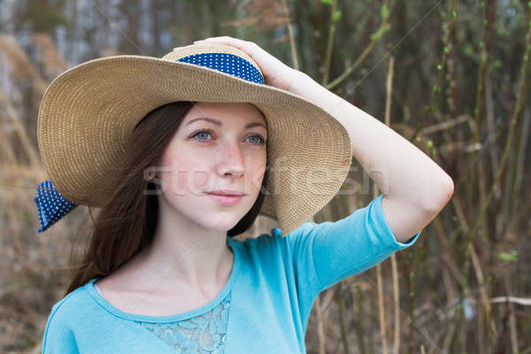 Freckled girl in hat in windy weather Stock photo © Agatalina