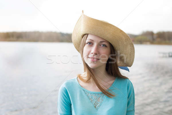 Freckled girl in hat looking at camera and smiling Stock photo © Agatalina