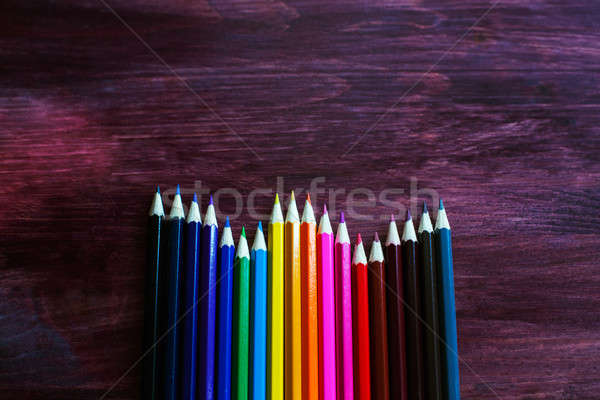 coloured pencils on brown background Stock photo © Agatalina