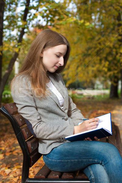 студент Дать пер ноутбук что-то улыбаясь Сток-фото © Agatalina