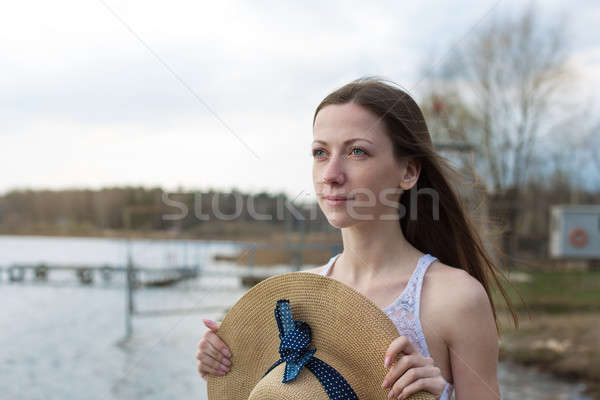 Freckled happy girl holding hat and looking away Stock photo © Agatalina
