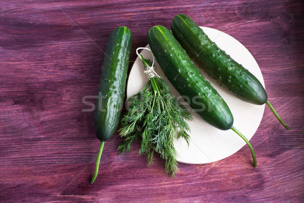 Bunch of dill and three fresh cucumbers Stock photo © Agatalina