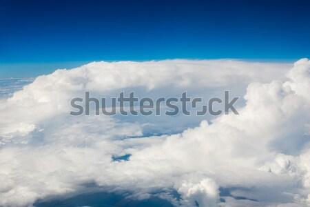 Niebo chmury górę widoku płaszczyzny świetle Zdjęcia stock © Agatalina