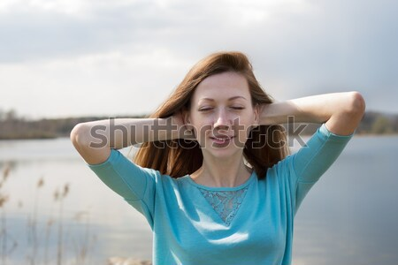 Freckled happy girl with closed eyes Stock photo © Agatalina