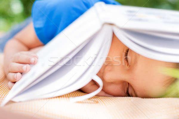 мальчика спальный книга пляж избирательный подход Сток-фото © Agatalina