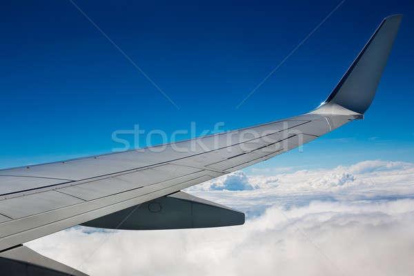 самолет крыло небе облака природы свет Сток-фото © Agatalina