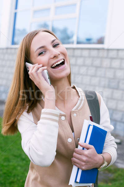 Student with phone and laughing Stock photo © Agatalina