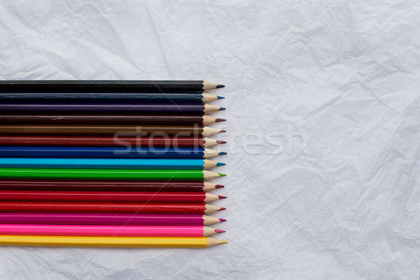 Crayons ion blanche fiche rangée Photo stock © Agatalina