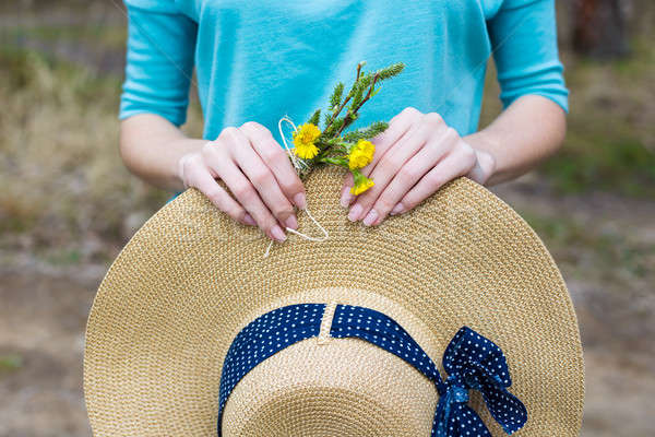 Straw hat and spring bouquet Stock photo © Agatalina