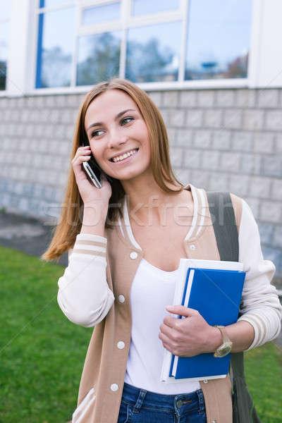 Estudante falante telefone móvel retrato Foto stock © Agatalina