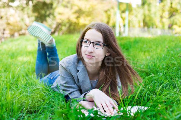 студент очки мышления трава книга зеленая трава Сток-фото © Agatalina