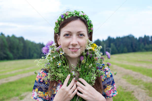 Girl standing with splitting flower bouquet Stock photo © Agatalina
