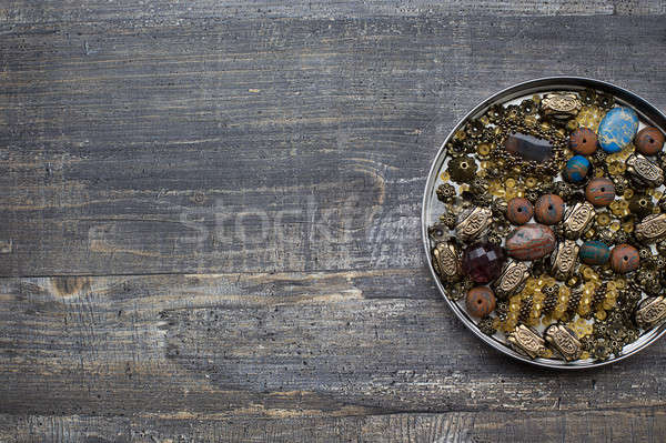Small beads into tin lid Stock photo © Agatalina