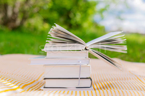 pile of books with one opened book Stock photo © Agatalina