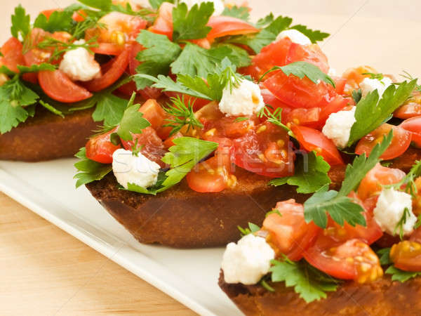 Bruschetta kerstomaatjes cottage cheese peterselie ondiep Stockfoto © AGfoto