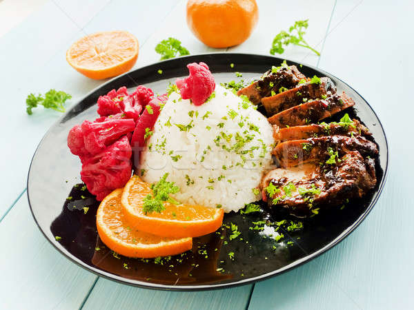 Pork fillet with rice Stock photo © AGfoto