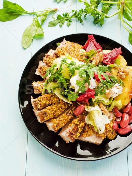 Pork ribs with veggies and herbs Stock photo © AGfoto