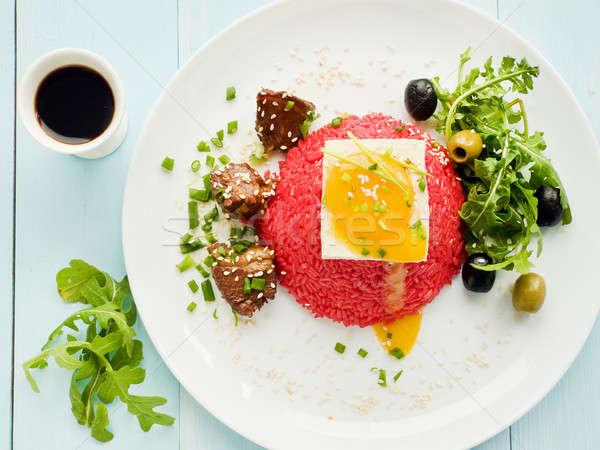 Rice with tofu and egg yolk Stock photo © AGfoto
