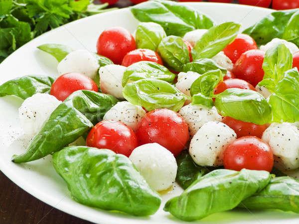 Caprese fresche insalata caprese pomodorini baby basilico Foto d'archivio © AGfoto