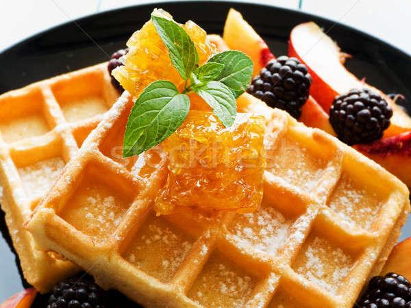 Belgium waffles with fruits and honey Stock photo © AGfoto
