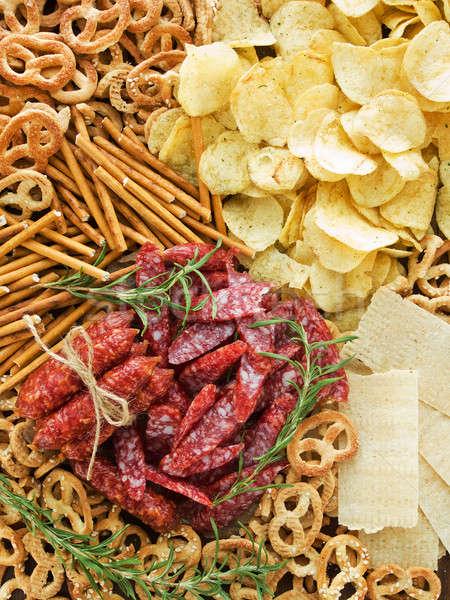 Сток-фото: картофельные · чипсы · крендельки · мяса · желтый · свежие