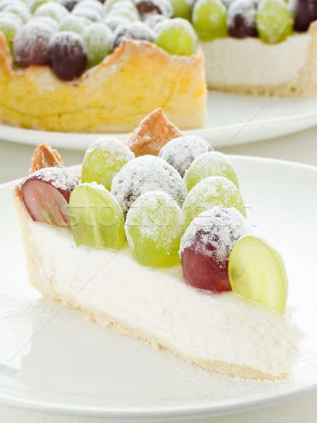 De uva tarta rebanada tarta de queso azúcar en polvo superficial Foto stock © AGfoto