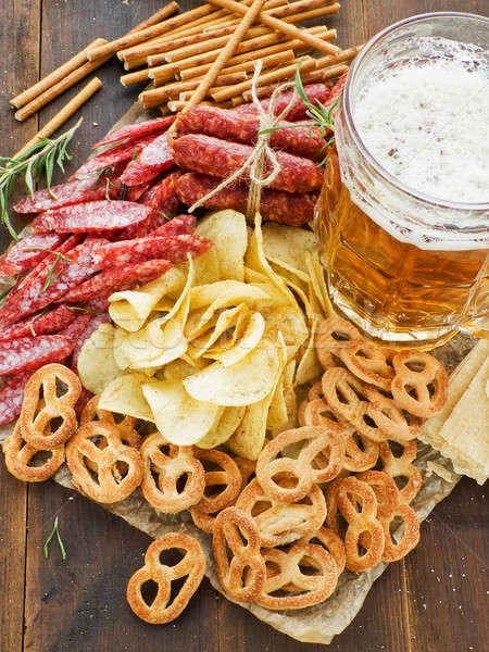 Сток-фото: пива · крендельки · картофельные · чипсы · золото · алкоголя