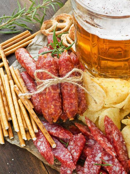 Сток-фото: пива · крендельки · картофельные · чипсы · стекла · алкоголя