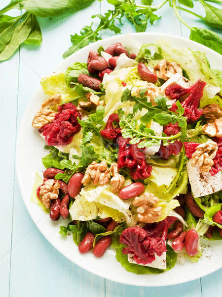 Salad with walnuts and various herbs Stock photo © AGfoto