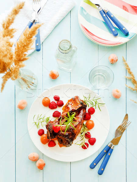 Pork ribs with berries Stock photo © AGfoto