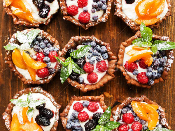 Tartlets with cheese and berries Stock photo © AGfoto