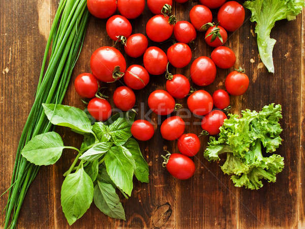 Cherry tomatoes and greens Stock photo © AGfoto