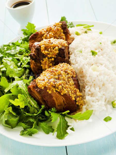 Carne de porco costelas arroz prato salada raso Foto stock © AGfoto
